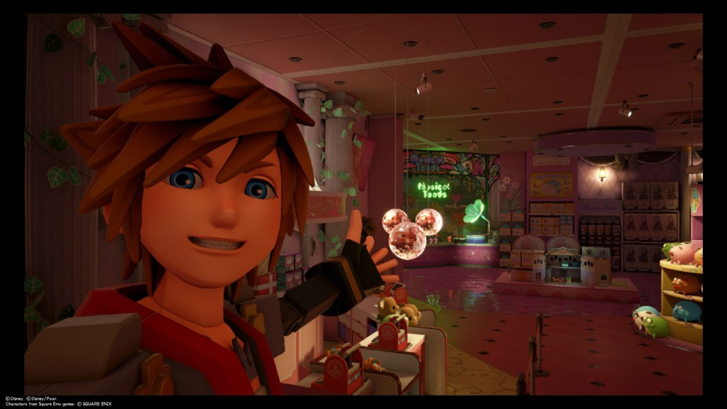 Sora takes a selfie in front of pink disco balls shaped like a Lucky Emblem at Galaxy Toys in Toy Box. Kingdom Hearts III, Square Enix, 2019.