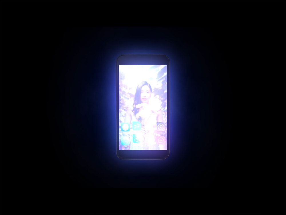 A bright, overexposed image of a mobile phone recedes into a completely solid black background. The phone's wallpaper of smiling, young woman holding flowers is faintly visible. From SIMULACRA 2, Kaigan Games, 2020.