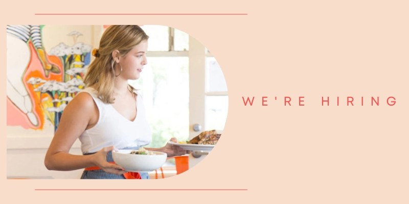 Woman holding a bowl and a plate with text: We're Hiring.