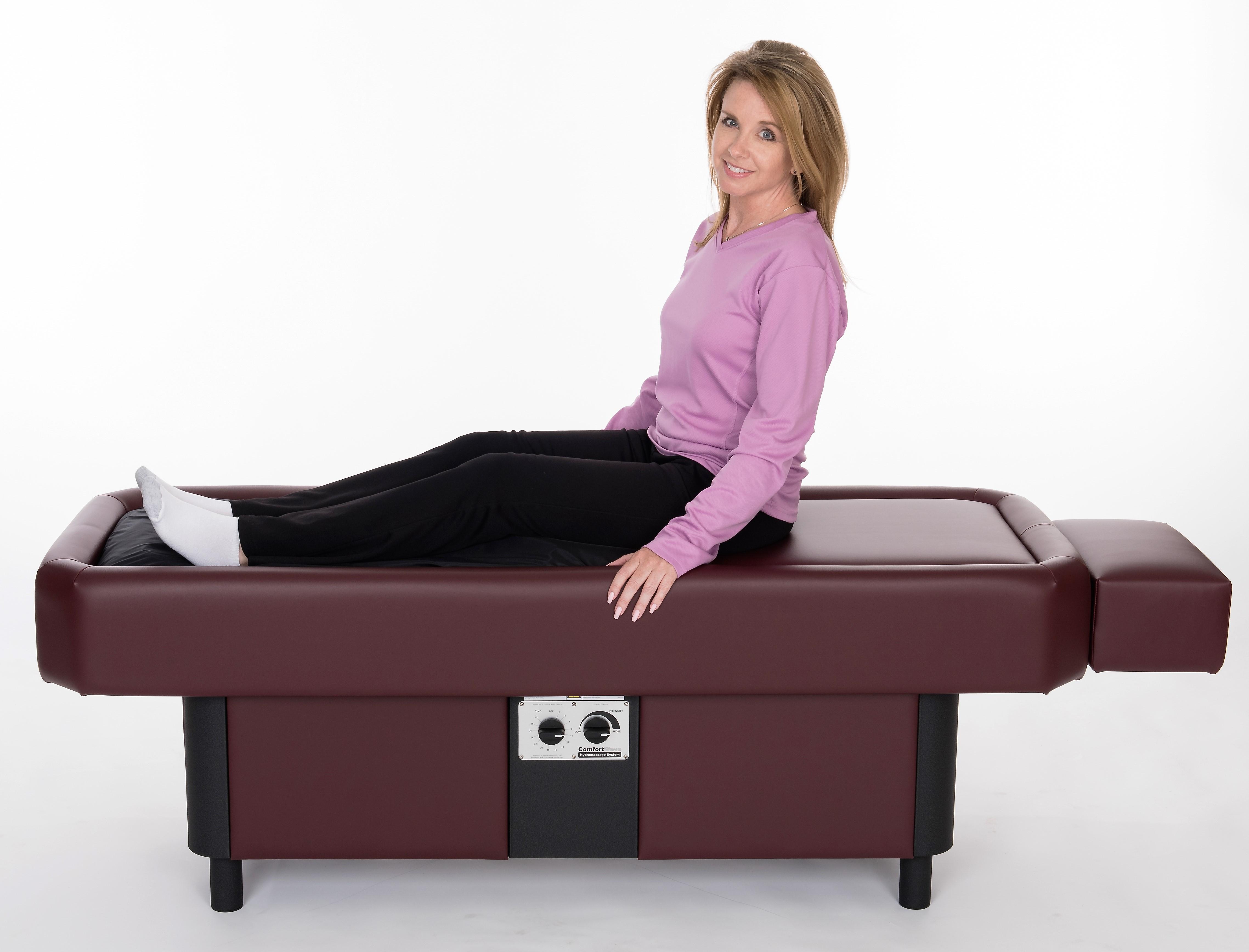 lady getting legs massaged on hydromassage table