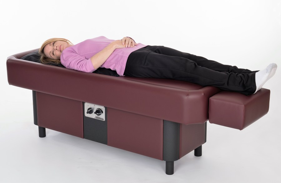 lady laying on ComfortWave hydromassage table