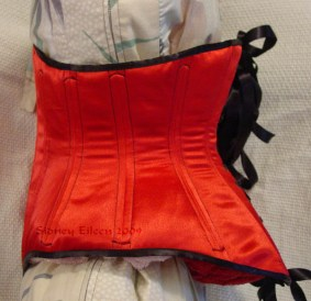 Reversible Waist Cincher - Red Side - Side View, by Sidney Eileen