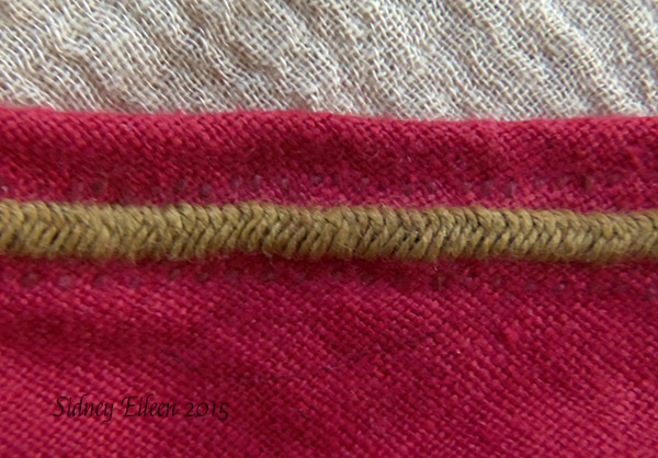 Red Open Hood - Seam Detail, by Sidney Eileen - Linen hand stitched and embroidered with linen thread, fishbone stitch detail decorating the main seam.
