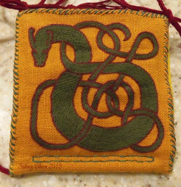 Great Wyrm Needle Book - Green Wyrm Detail, by Sidney Eileen, Stem stitch in DMC cotton floss on linen, hand stitched with linen thread.