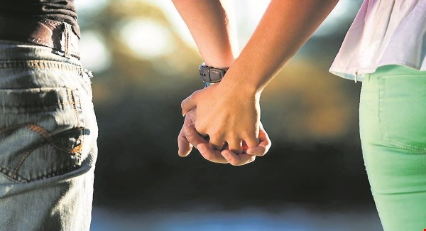 YoungCoupleHoldingHands050516_large