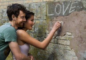 Girlfriend writing LOVE on a wall
