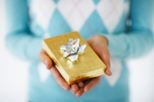 Woman Holding Small Gift
