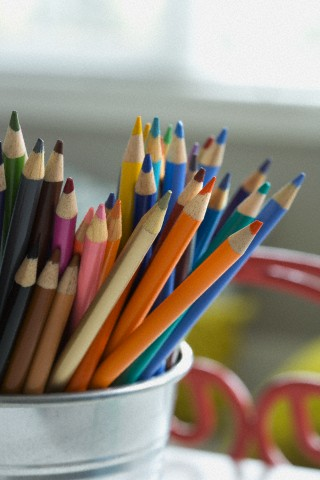 Close-up of colored pencils in desk organizer