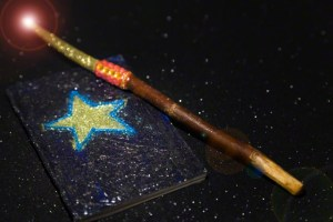 15 Jan 2012 --- Magic Wand and Booklet --- Image by © Snap Decision/Glasshouse Images/Corbis