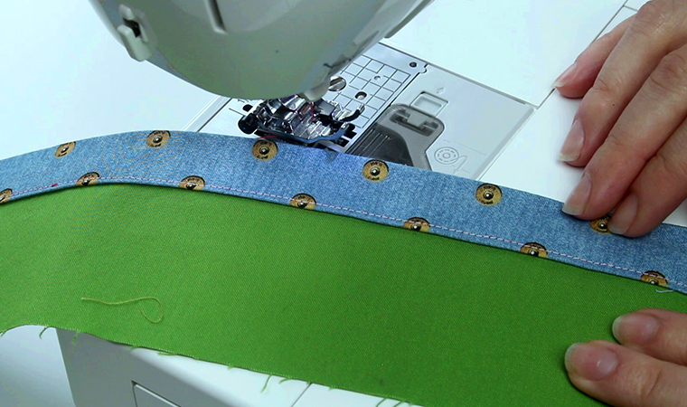The ditch stitching on the front catches the seam allowance fold on the inside of the skirt or pants.