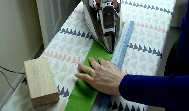 Press the seam allowance toward the waistband.