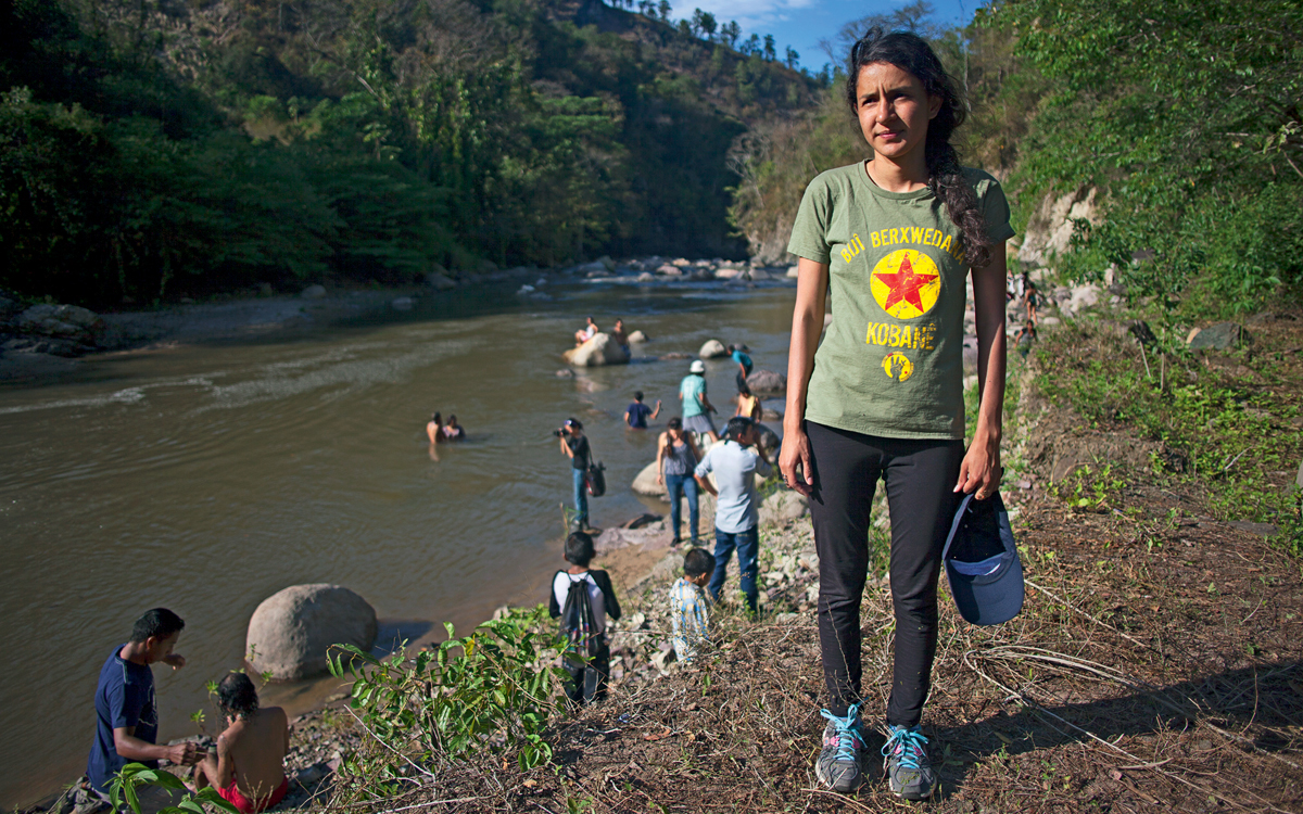Berta Caceres Zuniga (daughter of Berta Caceres) stands next to the Gualcarque River, which her mother died protecting.