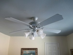 Guest room fan was 'disappeared' with ceiling paint...everything but the glass was painted with a small sea sponge