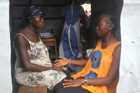Martha receives psychosocial counselling from Aisha Conteh, CHO at the temporary health post. ©UNFPA Sierra Leone /2017/Angelique Reid
