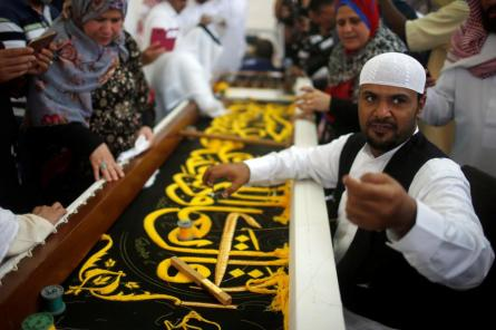 A man embroiders the Kiswa, a silk cloth covering the Holy Kaaba, ahead of the annual haj pilgrimage, at a factory in the holy city of Mecca