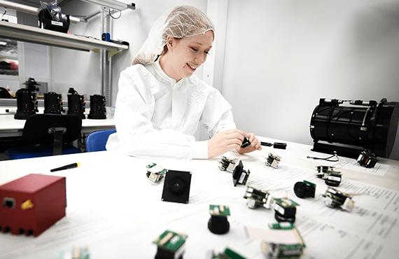 Sierra-Olympic engineer at work assembling cameras