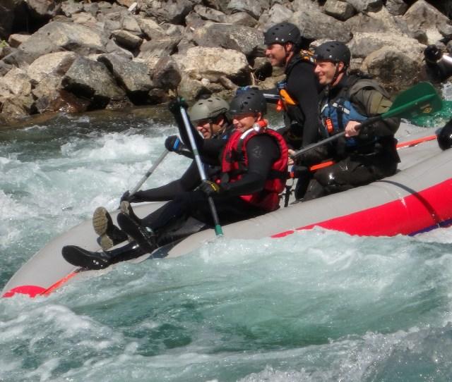 Paddling Flipped Raft On River