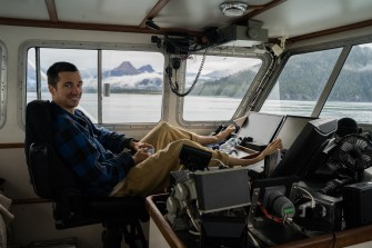 Taking the boat to Seward and Volcanos in the distance