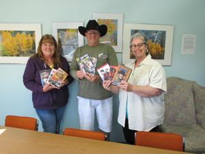 (LtoR) Patti Heinrichs, June Lake Historical Society, Ken Harrison, amateur film historian, Vineca Hess, June Lake Librarian.
