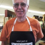 Boarmember Rich White's apron answered a persistent question at last year's picnic. Photo by Jon Klusmire