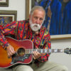 Carne Lowgren playing guitar