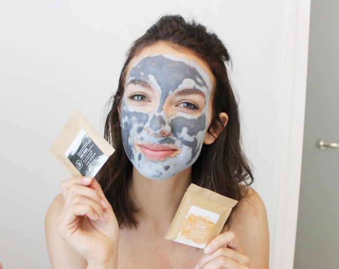 A woman showing face masks.