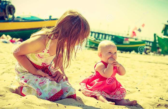 Toddler Girl Having Fun With Child On Beach Stock Photo - Image of ...