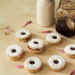Linzer Cookies on a beige background