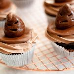Sorting hat cupcakes sitting on a brass tray