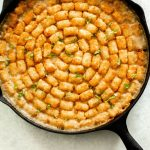 Gluten Free Vegetable Tater Tot Casserole in a cast iron pan.