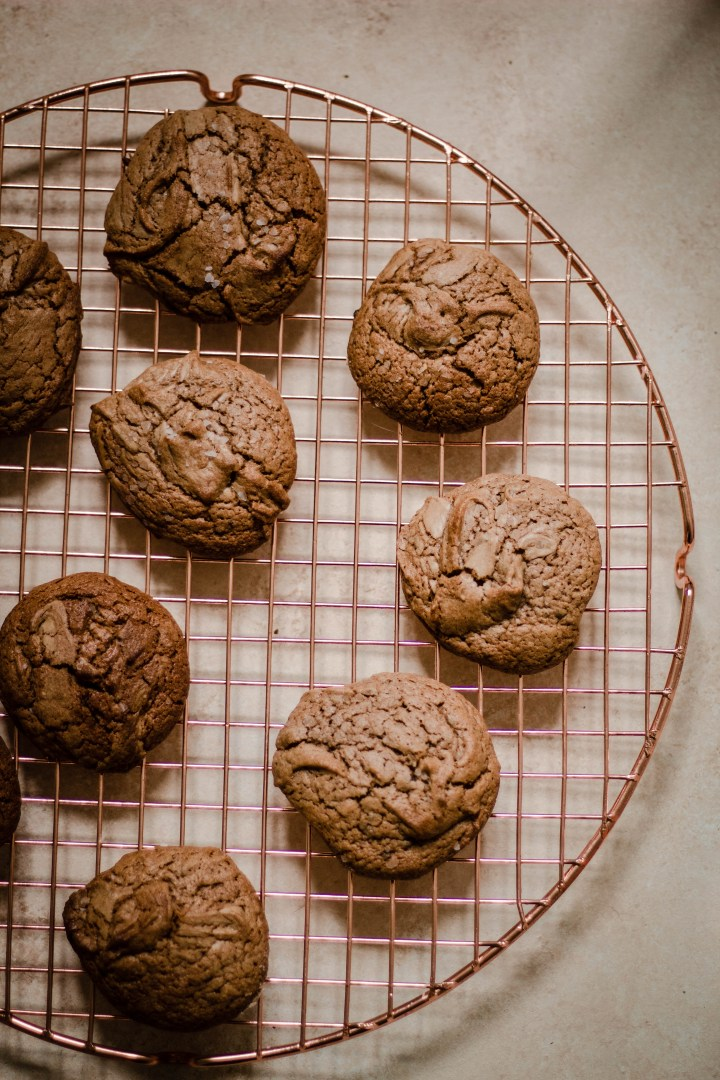 Gluten Free Tahini Chocolate Chip Cookies on a wire rack