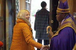 Greeting parents and families at St Lawrence Church