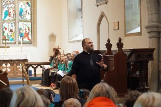 Revd Andy Simpson at Sigglesthorne CofE Primary School Easter Service in St Lawrence Church