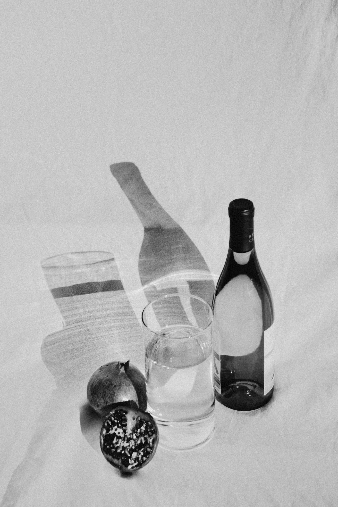 still life fruit shadows light play moody black and white fine art photography