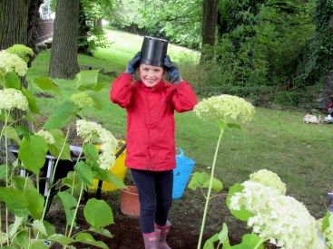 Susan's daughter, Ursula, having a laugh at our graveyard planting day, July 2016.