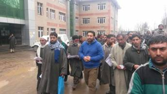 Dr Shaikh Ghulam Rasool leads a group of RTI users to file RTI en masse at the District Collector's office in Bandipore.