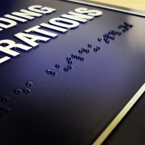Braille on Sign