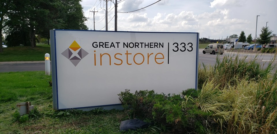 cabinet sign with Great Northern Instore panels