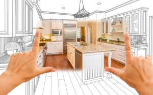 Female Hands Framing Custom Kitchen Design Drawing and Square Photo Combination.