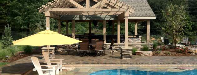 Kalamazoo Recessed Free Form Pool, Outdoor Kitchen, Firepit and Putting Green
