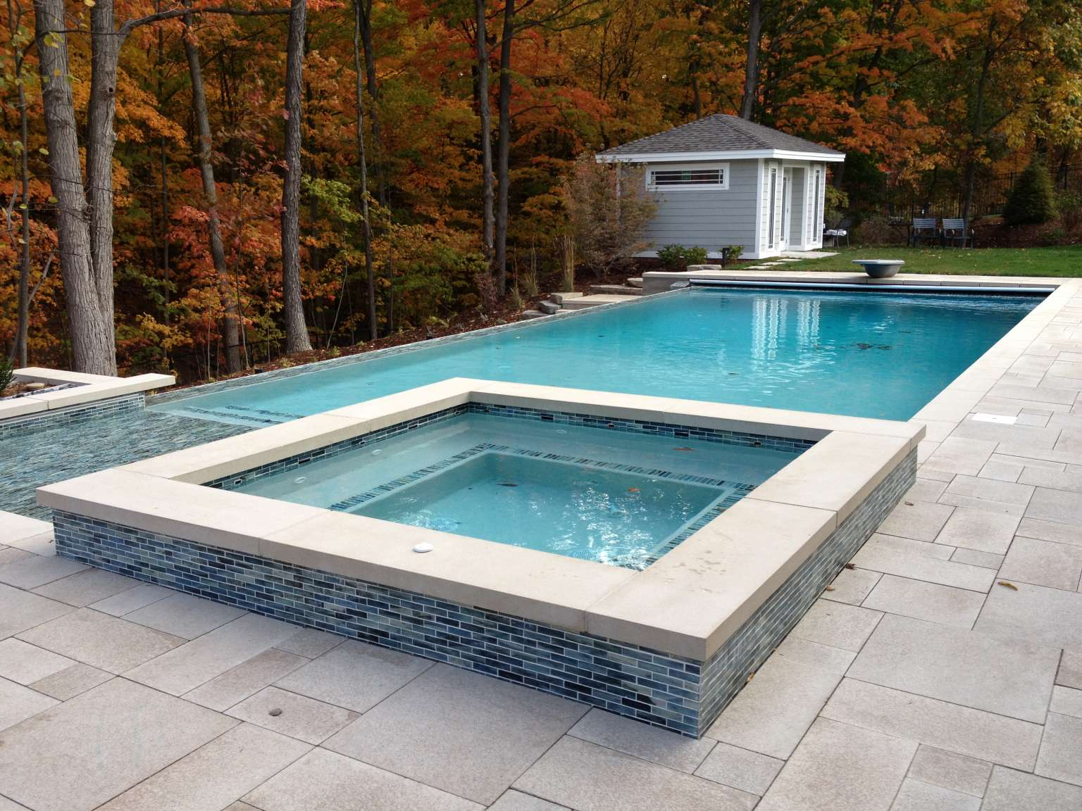 Grand Rapids Modern Infinity Edge Pool Attached Spa