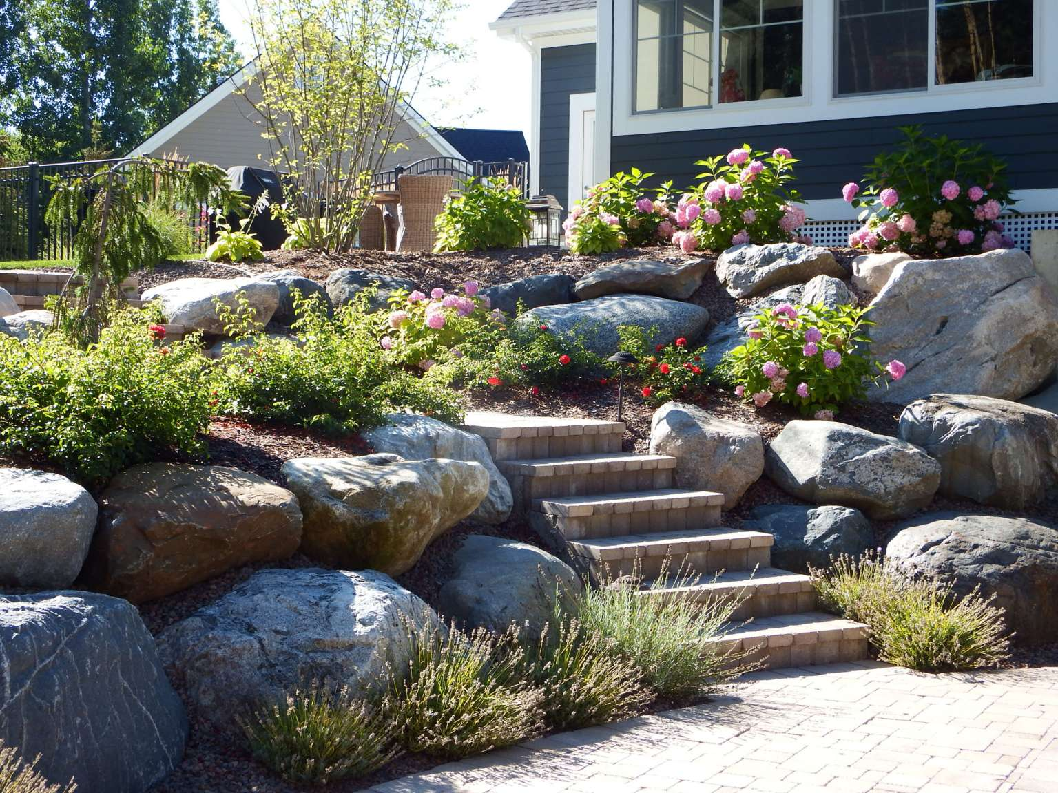 Cascade Pool With Natural Stone Detail Retaining Walls