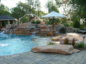 rock and paver pool deck with jets