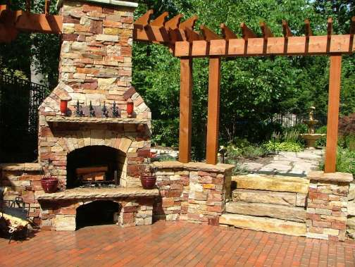 stone fireplace and wood trellis