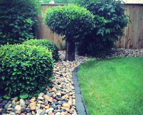 shrub & rock bed signature landscaping
