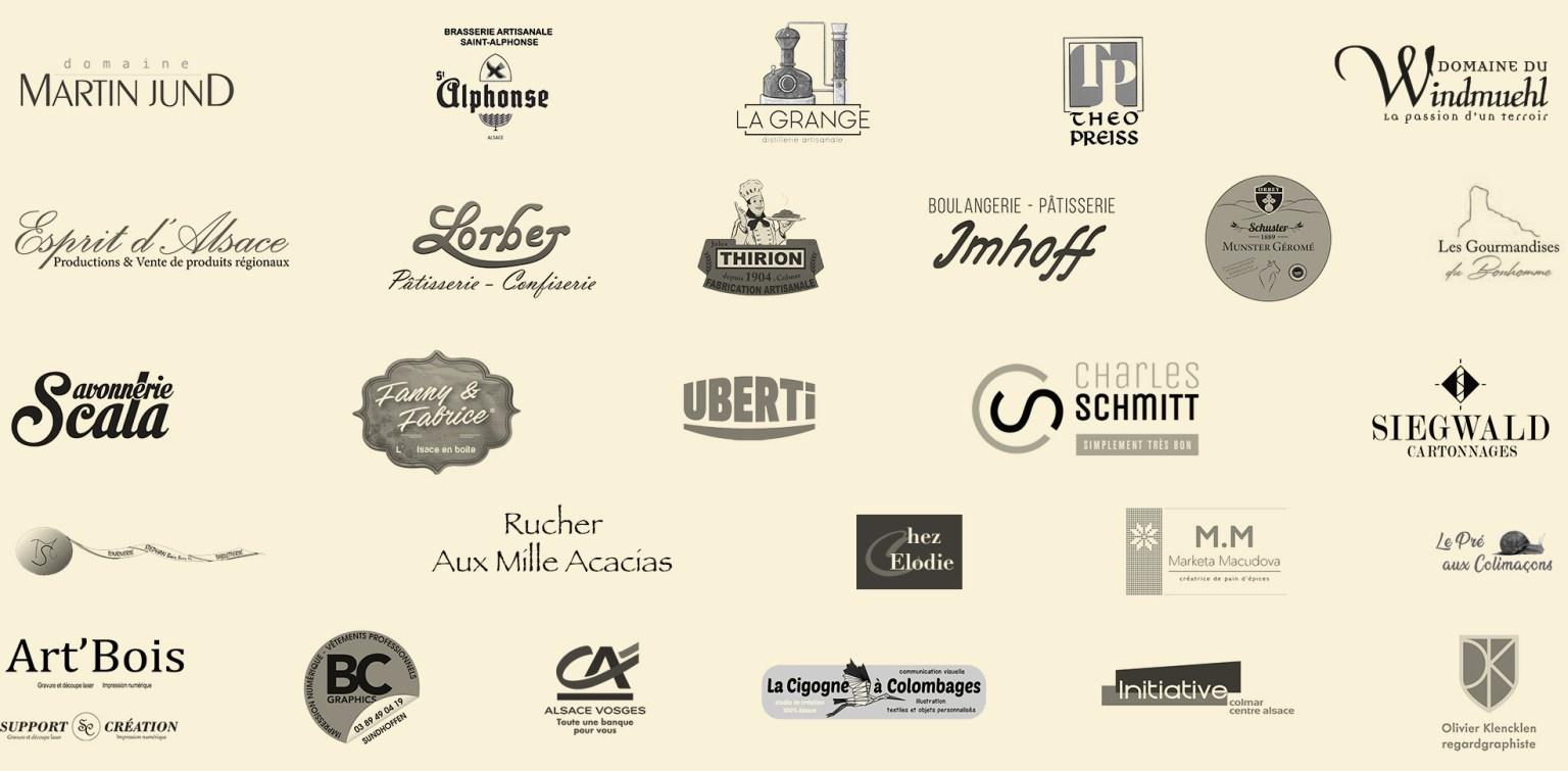 Section présentant les logos des principaux partenaires et fournisseurs des Colmar Box - Signatures d'Alsace