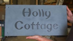 Raised and unpainted Slate House Sign