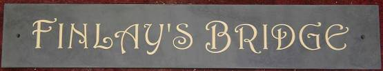Slate house sign with cream lettering