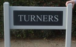 Wooden Entrance sign with engraved Corian insert on posts