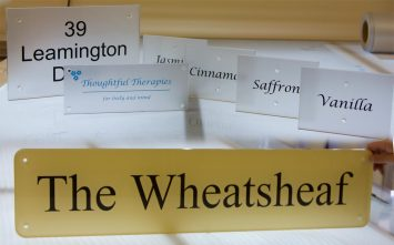Clear Acrylic - https://www.sign-maker.co.uk/clear-acrylic-signage-74-c.asp
